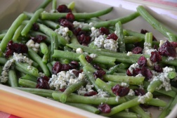 https://sallycooks.com/2013/11/06/green-beans-with-cranberries-and-blue-cheese/