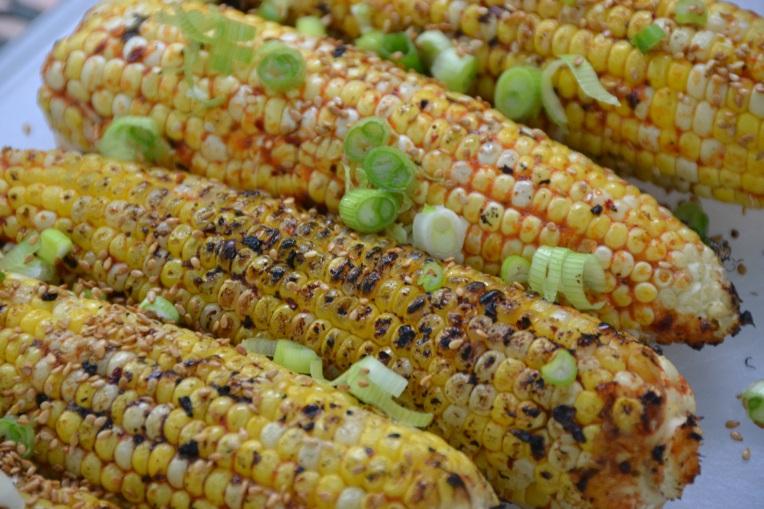 https://sallycooks.com/2014/04/28/spicy-sesame-glazed-grilled-corn/