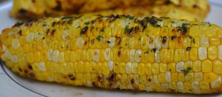 https://sallycooks.com/2014/06/06/grilled-corn-with-basil-butter/